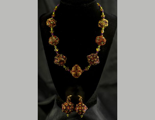 "18"" Necklace with Earrings.  The necklace consists of 7, 3 dimensional beaded beads 3/4 to 1"" in diameter made of glass beads in gold, orange, purple and lime green. By Patricia Hinga $200.00"